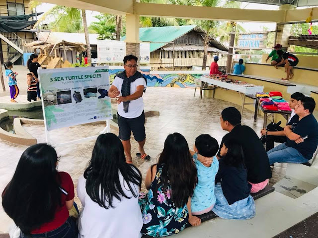 Mang Manolo explains the importance of Pawikan Conservation Center