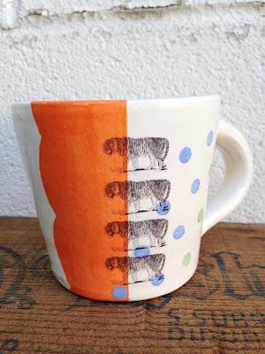 tigers on orange stripe mug