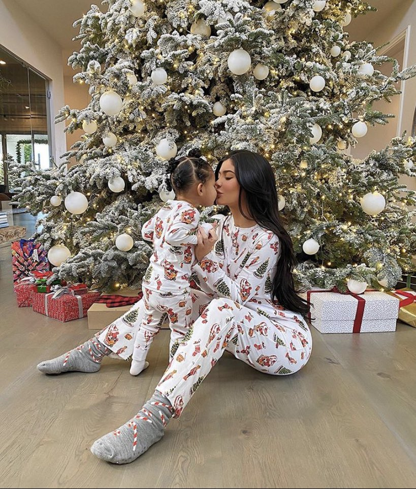 Kylie Jenner shares a sweet kiss with daughter Stormi as they wear matching holiday onesies on Christmas Day