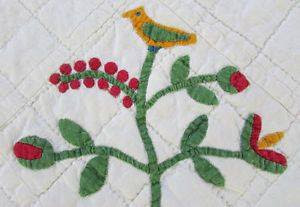 antique quilt with bird on berry foral