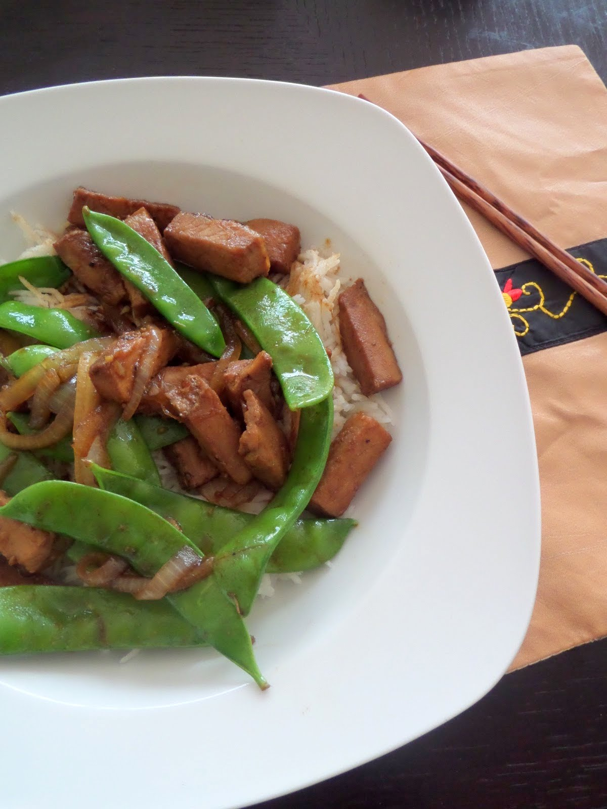 Pork and Peas Stir Fry:  A sweet and spicy stir fry made with leftover Herb Roasted Pork Tenderloin and a variety of peas.