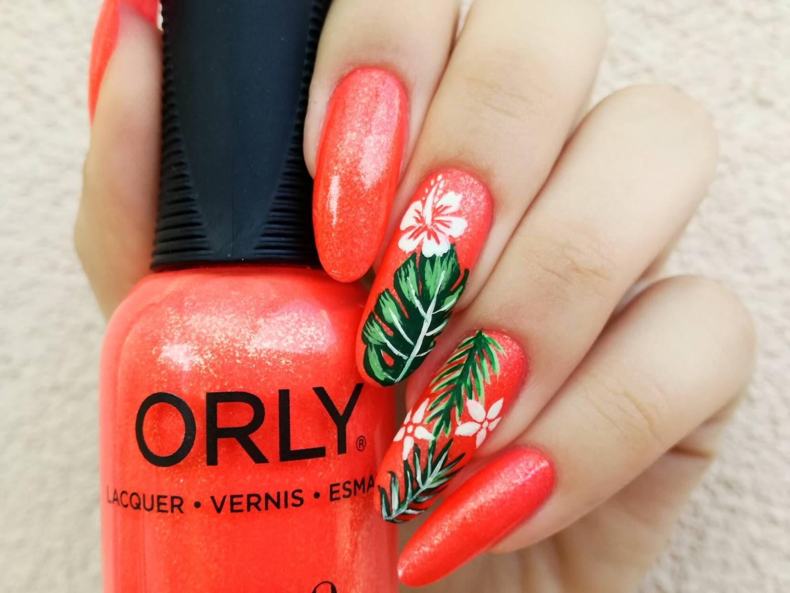 Neonowe pomarańczowe paznokcie - tropikalne liście