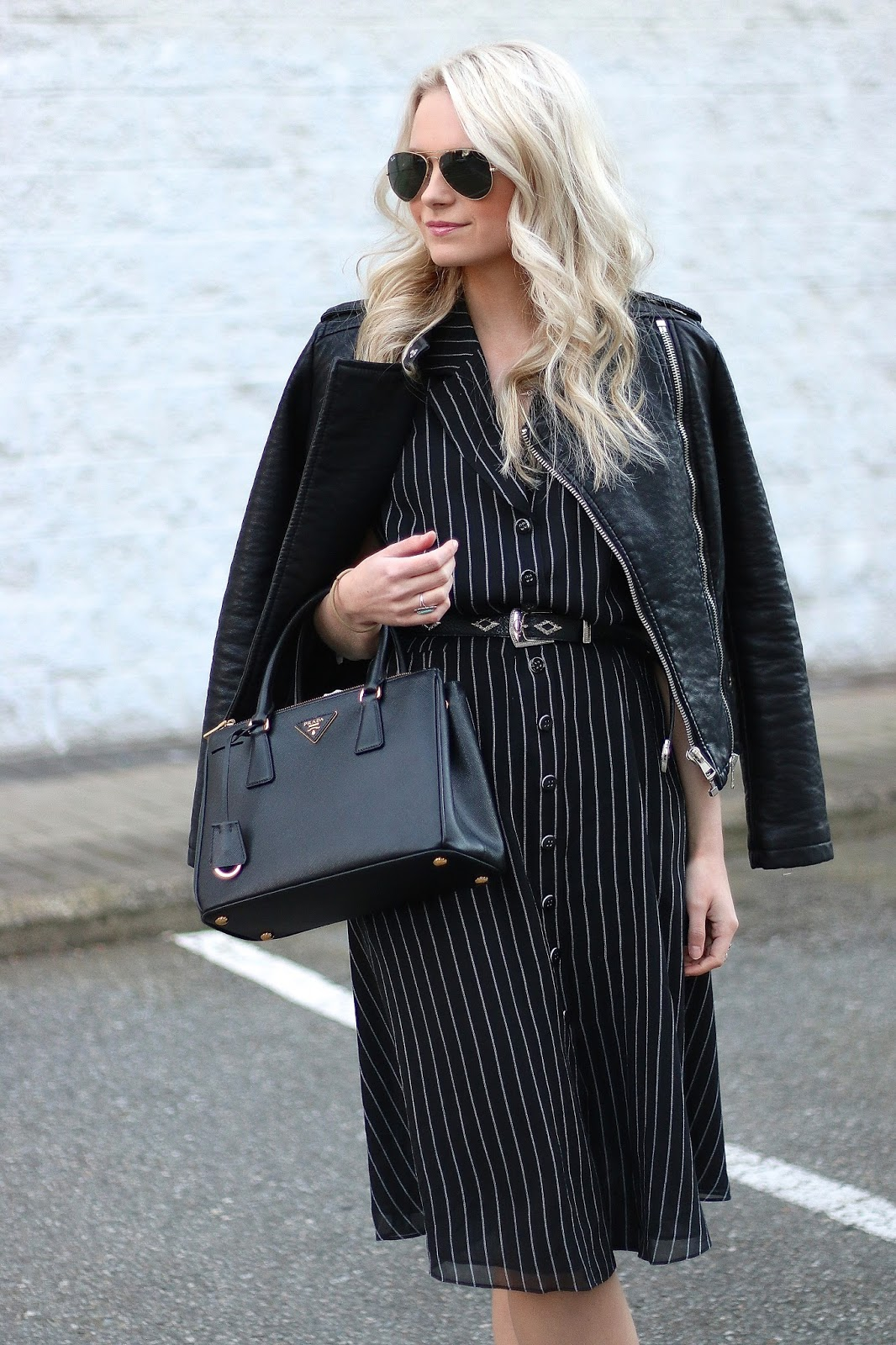 blogger wearing midi pinstripe dress and Prada handbag