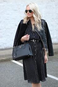 blogger wearing midi pinstripe dress and Prada handbag