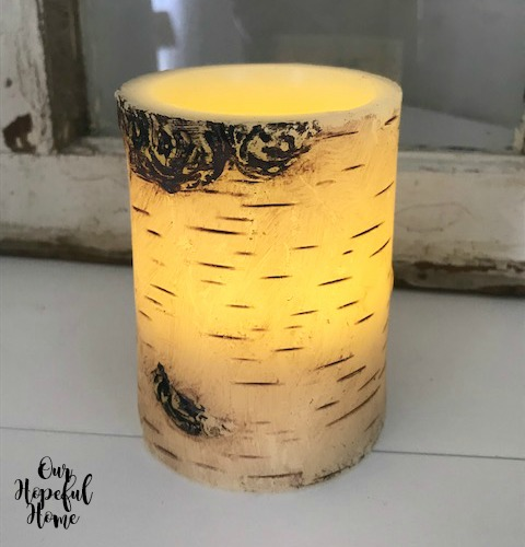 brightly lit faux rustic birch bark LED candle