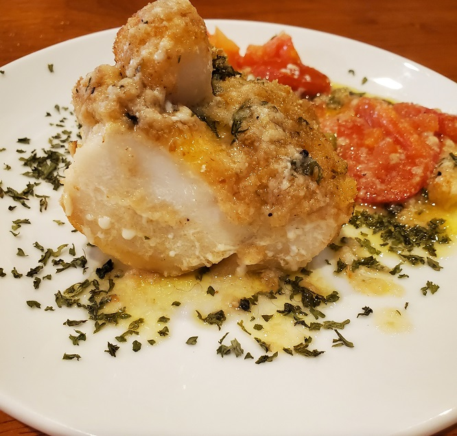 this is haddock topped with scallops breadcrumbs with a lemon butter dill sauce