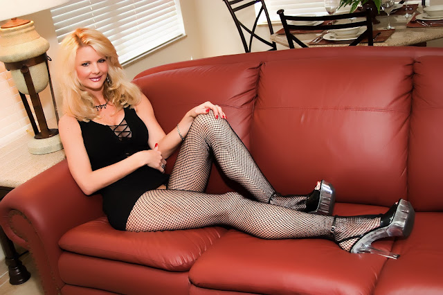 young beautiful blonde woman on couch