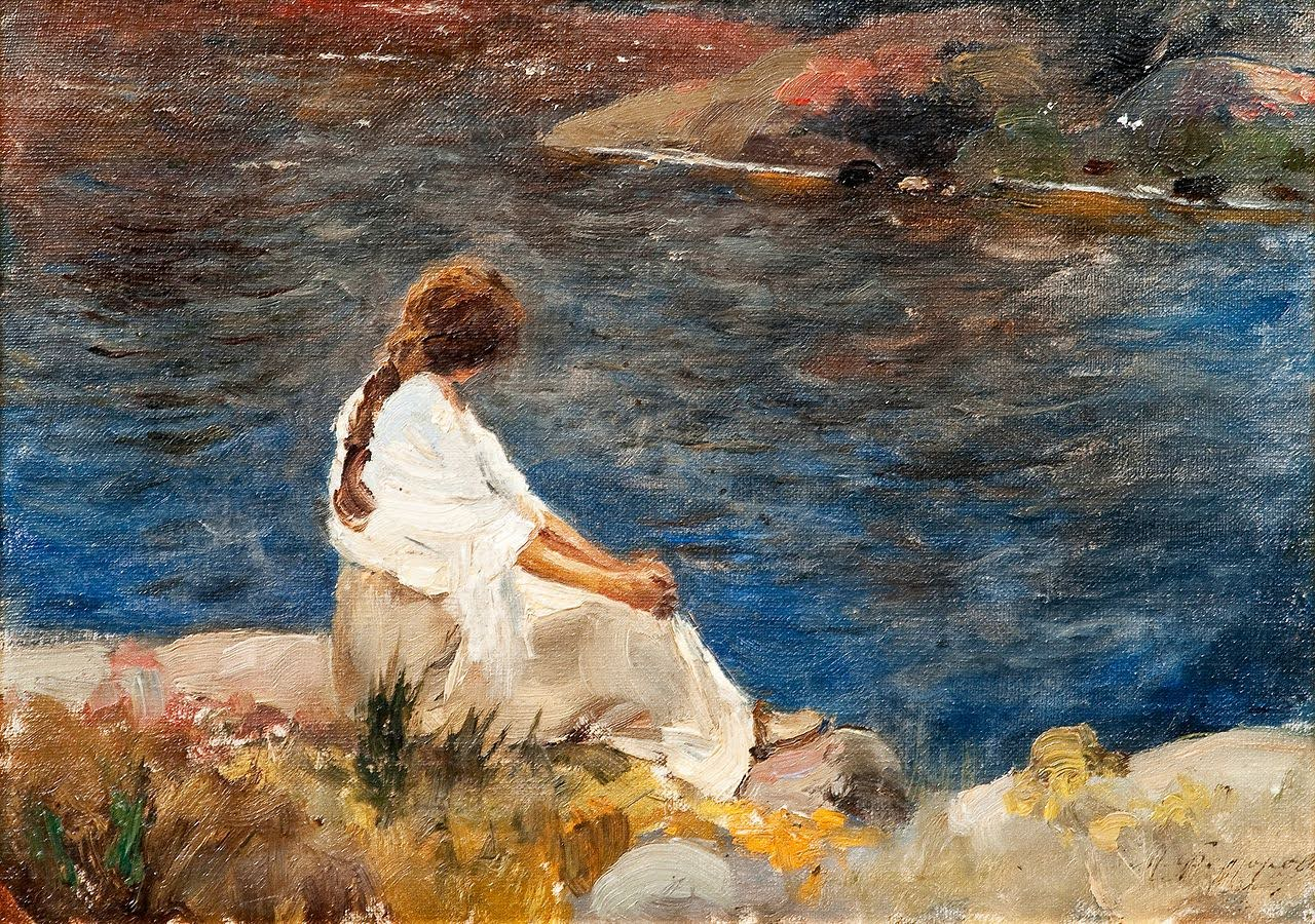 Girl is sitting near the river