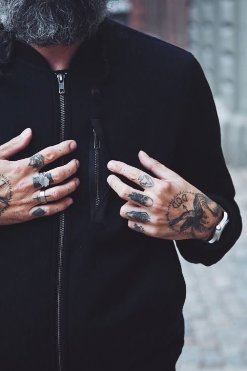 skull design tattoo on finger