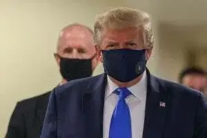 Trump finally wears face mask as US sets new virus case record