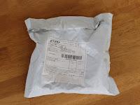 中国郵政を使って届いたEW-83E レンズフード