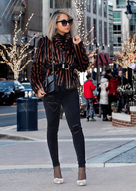 faux fur coat paired with high waist skinny jeans