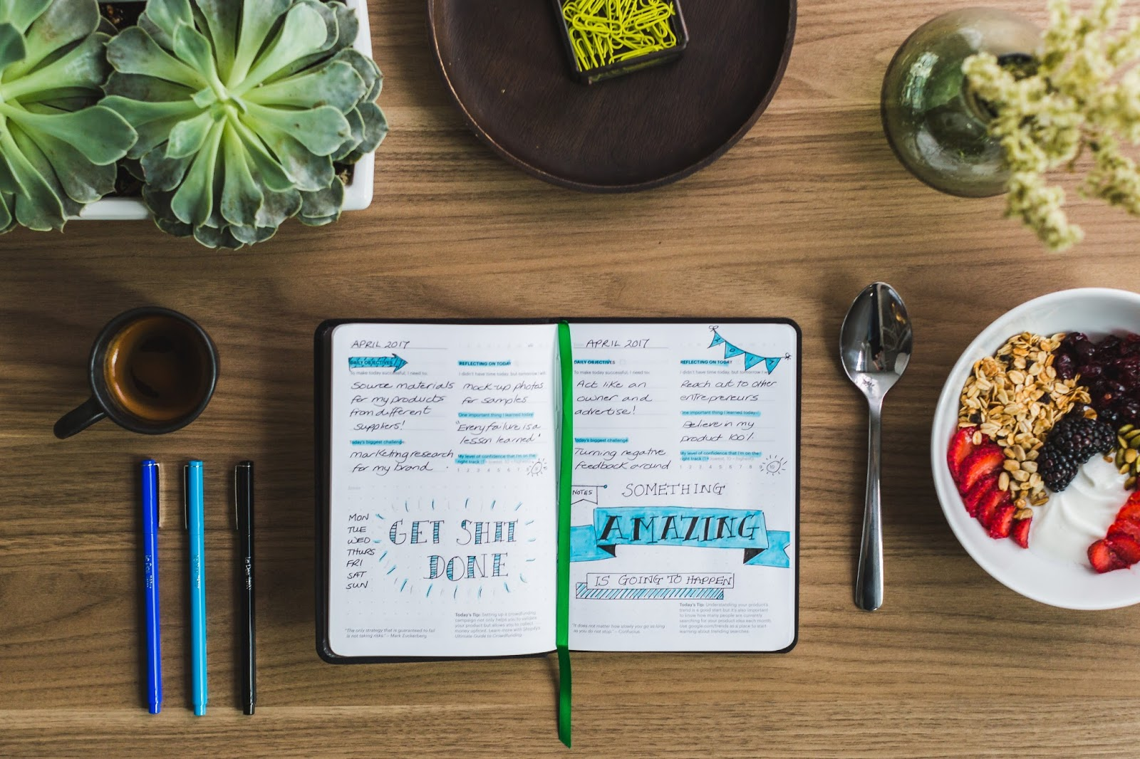 Journal with notes open at the breakfast table