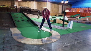Playing at Holey Molies Miniature Golf in Skelton-in-Cleveland