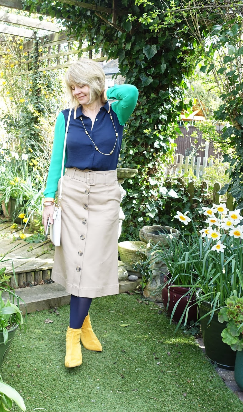 Staying positive: over-50s blogger Gail Hanlon in green and navy Scotch and Soda blouse with coffee coloured A line midi skirt from Marks and Spencer