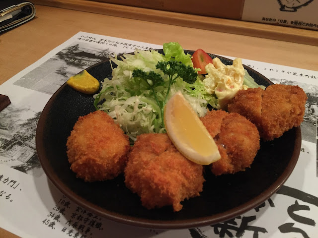 a photo of the best tonkatsu in tokyo with slice of lemon on top and fresh karashi mustard