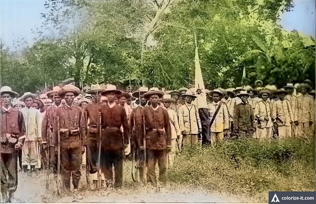 "Filipino revolutionaries in |formation.  Image extracted from the book ""History and Description of Picturesque Philippines.  Colorized courtesy of Algorithmia."