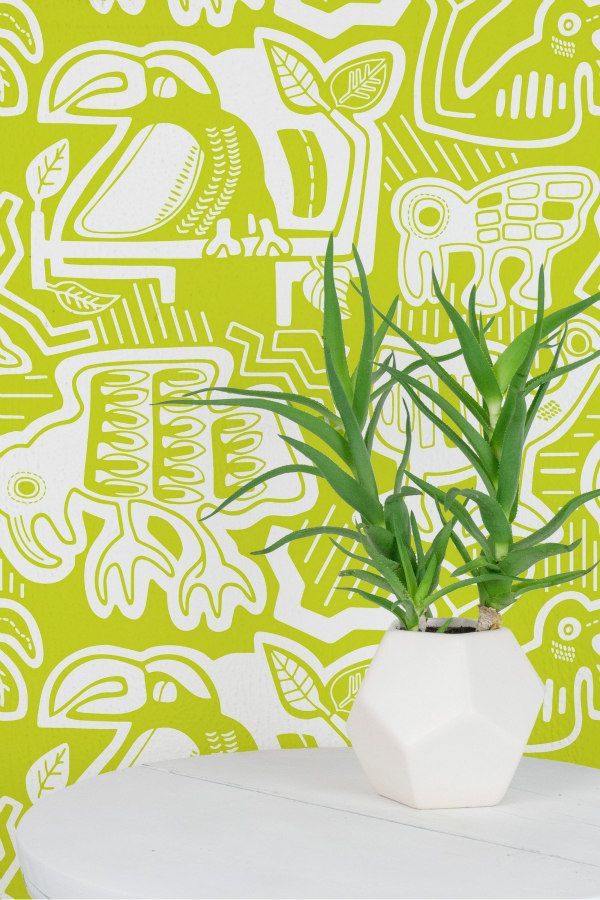 lime and white green patterned wallpaper in kuna design