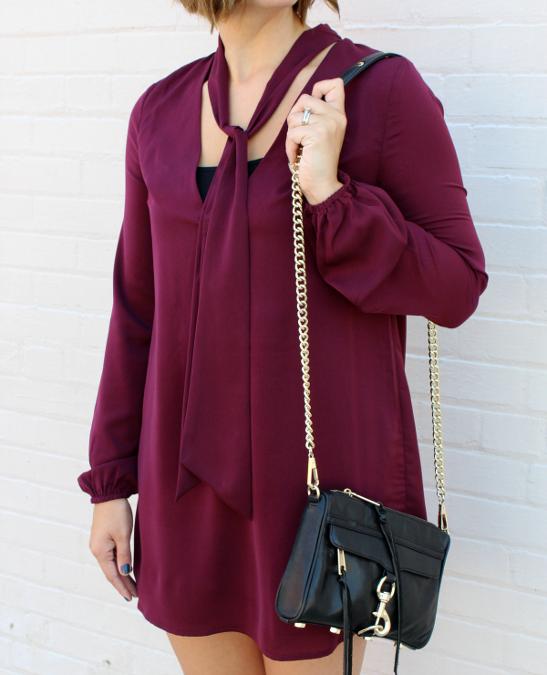 wine colored dress, black crossbody bag