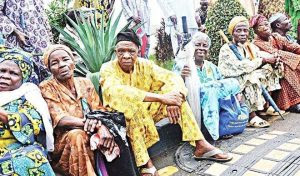 JustIn: Benue Pensioners Hold Church Service At Govt House Gate, Vow To Stay Until Paid