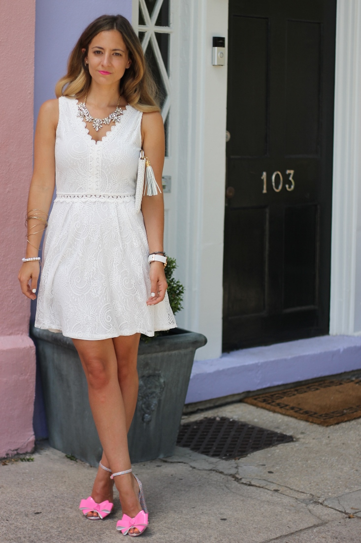White lace dress with crystal gemstone necklace