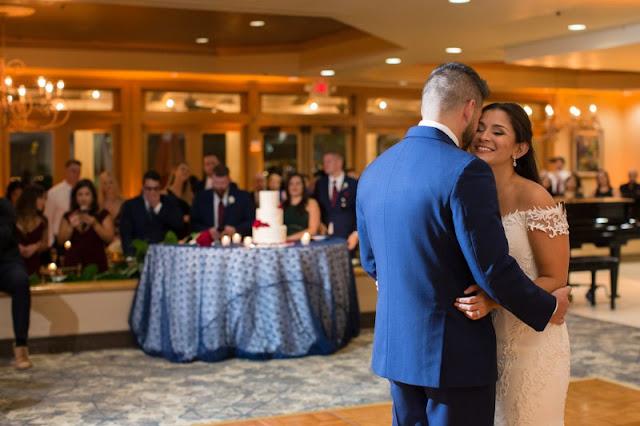 bride and groom smiling dancing