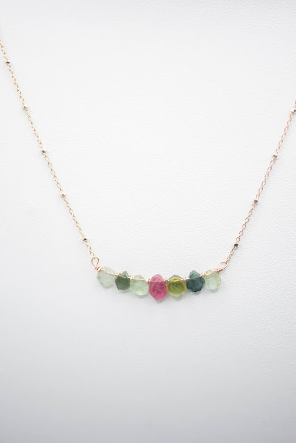A natural stone rainbow adds delicate beauty. Image credit Raw Amor.