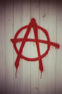 Anarchy symbol, which is the letter A and a circle through it.