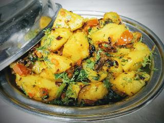 Serving jeera aloo in a bowl for jeera aloo recipe
