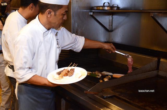 Chef at work preparing my grilled food