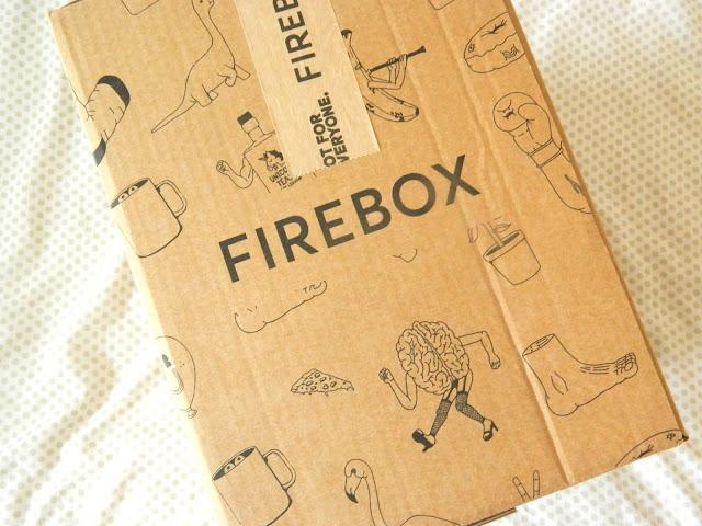 A cardboard shipping box from Firebox