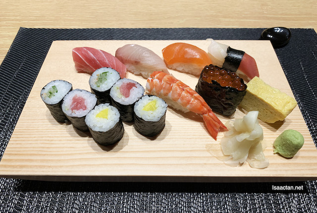 Seven different kinds of sushi on a platter, served with Miso Soup