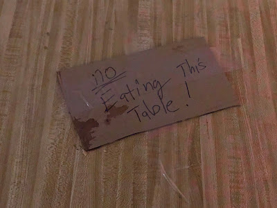 """Sign on table: """"No eating this table!"""""""