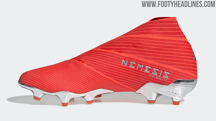 4ea05a032bde The 3 Stripes sit on the outside rear of the Adidas Nemeziz 19 boots. They  are colored in a shimmery silver-metallic, just like the outsole on the  Nemeziz ...