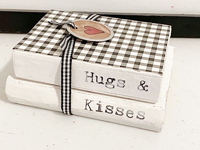 black and white scrap book paper and ribbon on book stack