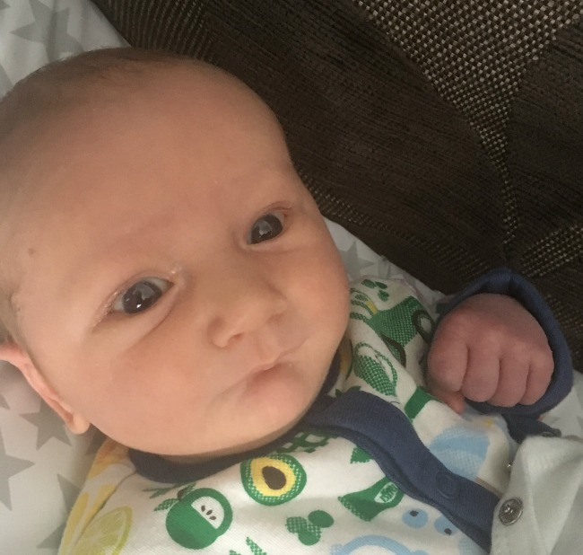 new-born-baby-with-eyes-open-looking-but-not-focusing