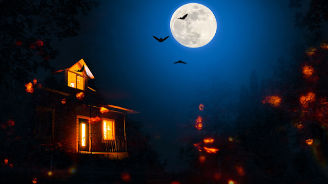 a haunted house and bats flying under the full moon
