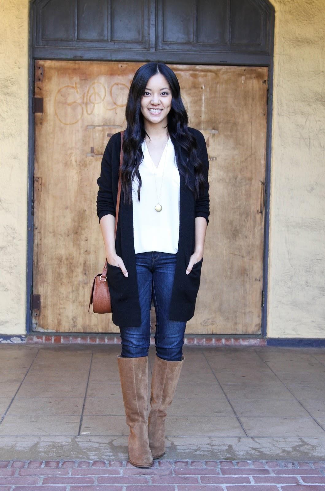 Black Cardigan + White Tunic + Pendant Necklace + Riding Boots