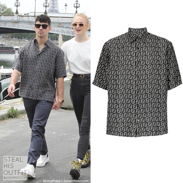 Joe Jonas in black logo print shirt in Paris