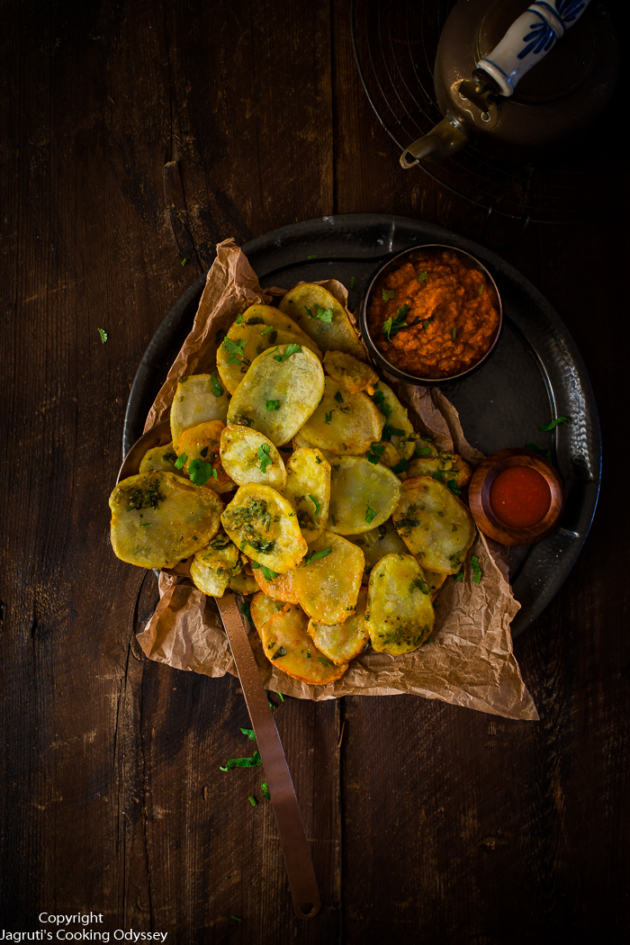 These kenyan style crispy golden potato fritters served on a pewter plate with red chutney.