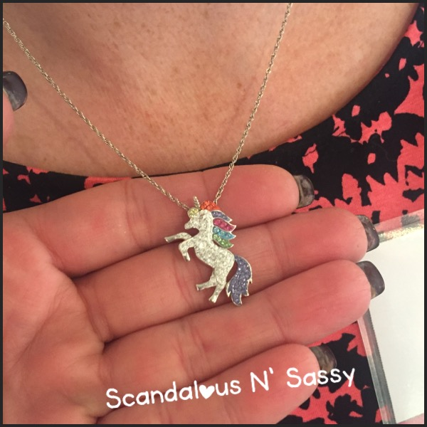 Lou with her sparkly unicorn pendant