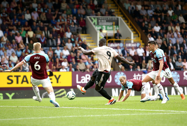 Romelu Lukaku of Manchester United scores his team's second goal past Ben Mee of Burnley during the Premier League match between Burnley FC and Manchester United at Turf Moor on September 2, 2018 in Burnley, United Kingdom.