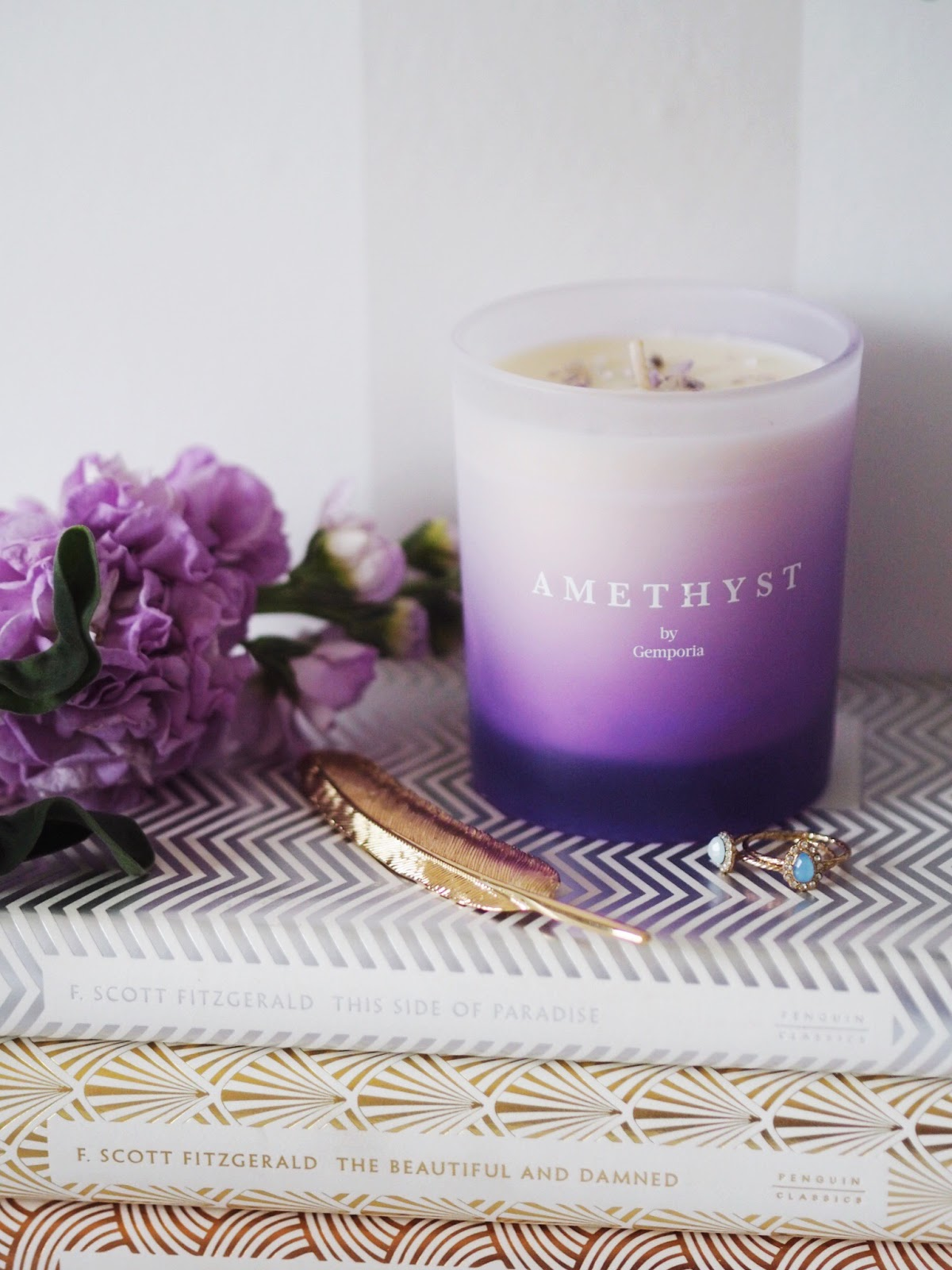 Gemporia Birthstone Candle February Lilac Stocks and Jewellery on some special edition Fitzgerald Books