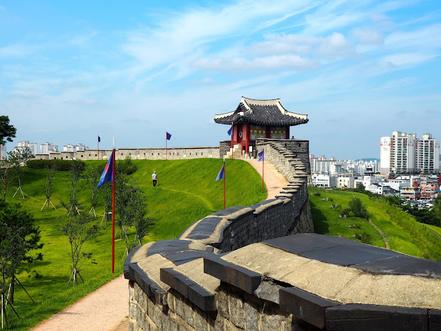Blue flags and lookout post on Hwaseong Fortress walls, around Suwon, Gyeonggi-do, South Korea