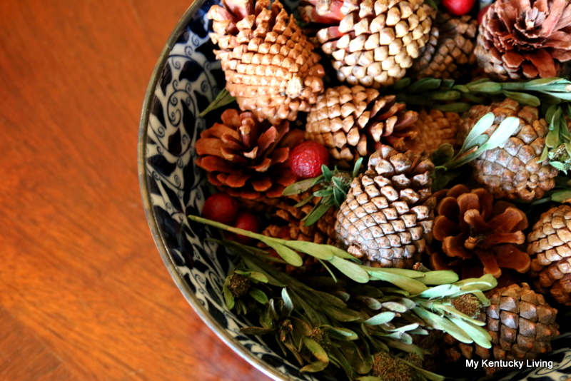 Christmas Decorating With Pine Cones, Berries, And
