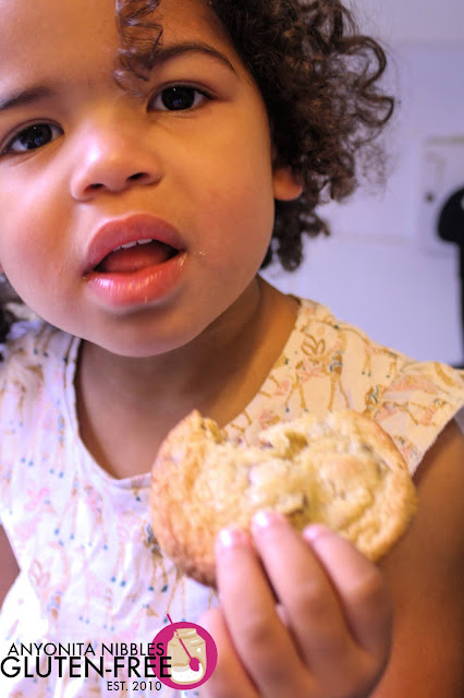 Girl eating a gluten-free chocolate chip cookie | Anyonita Nibbles Gluten-Free