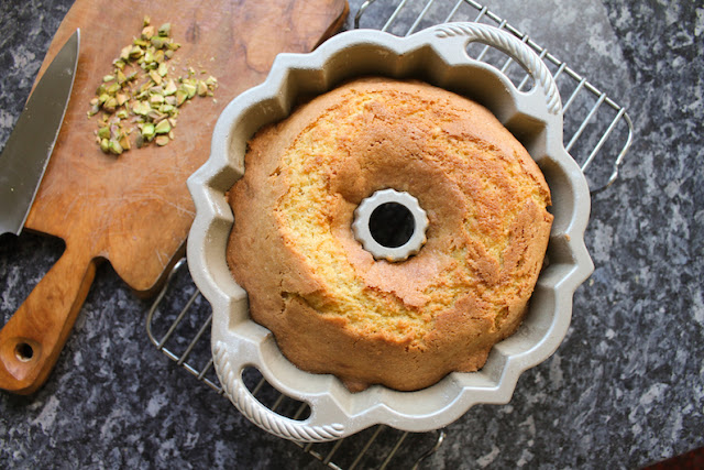 Food Lust People Love: Orange almond cake batter is spooned onto sweet roasted rhubarb and baked to golden perfection for a beautiful dessert your whole family will adore. Drizzled with the sticky rhubarb syrup and topped with chopped pistachios for a hit of color and crunch, this roasted rhubarb upside down cake is our new favorite sweet treat.