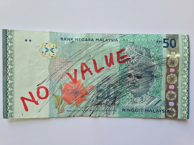 Berapa Nilai Duit Kertas Ringgit Malaysia Yang Rosak Dan Koyak Bila Ditukar Di Bank?