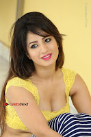 Cute Telugu Actress Shunaya Solanki High Definition Spicy Pos in Yellow Top and Skirt  0430.JPG