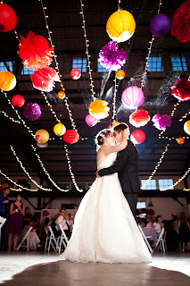 first dance at wedding reception light ceiling colorful